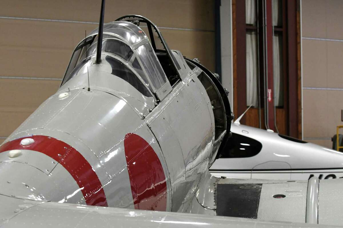 """Tora 101, a Japanese Zero movie replica owned by Integra Optics CEO David Prescott, sits in a hanger at Albany International Airport where is being restored on Friday, Dec. 7, 2018, in Colonie, N.Y. The aircraft was once used by the Canadian military before being converted to appear in three Hollywood films, including """"Tora! Tora! Tora!""""*, """"Midway"""" and """"Baa Baa Blacksheep.?"""" The aircraft was converted from a Canadian Car & Foundry Harvard IV. (Will Waldron/Times Union)"""
