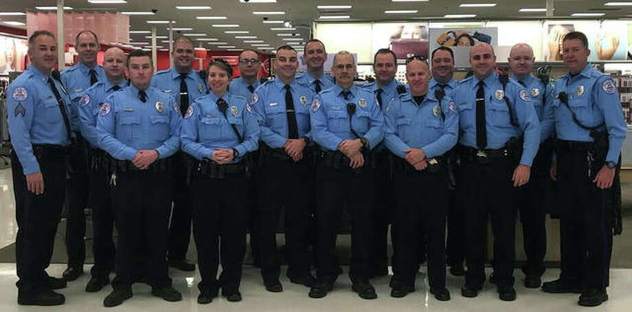 "Edwardsville Police Department officers pause for a photo during 2017's ""Christmas with a Cop"" event at Target. Photo: Courtesy Of The Edwardsville Police Department"
