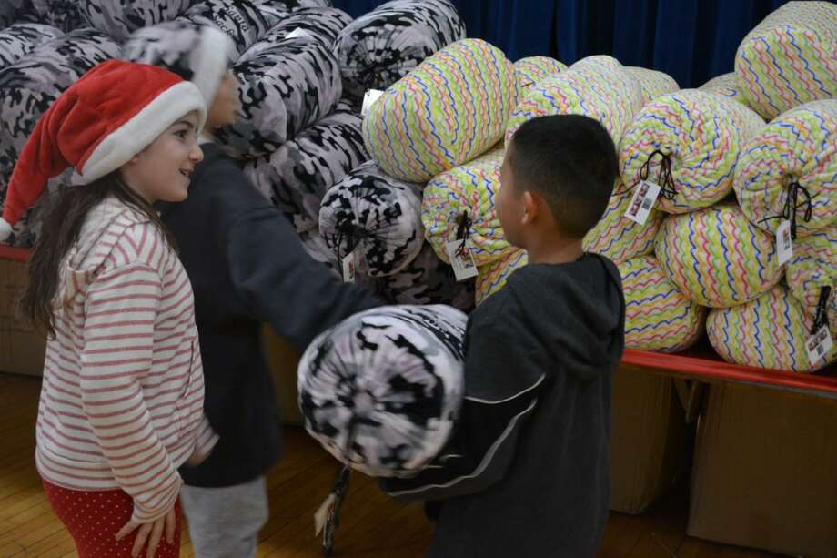 Children at the Boys & Girls Club of Greenwich will each receive a free blanket, thanks to the generosity of Michael Carino and his family. Photo: Contributed