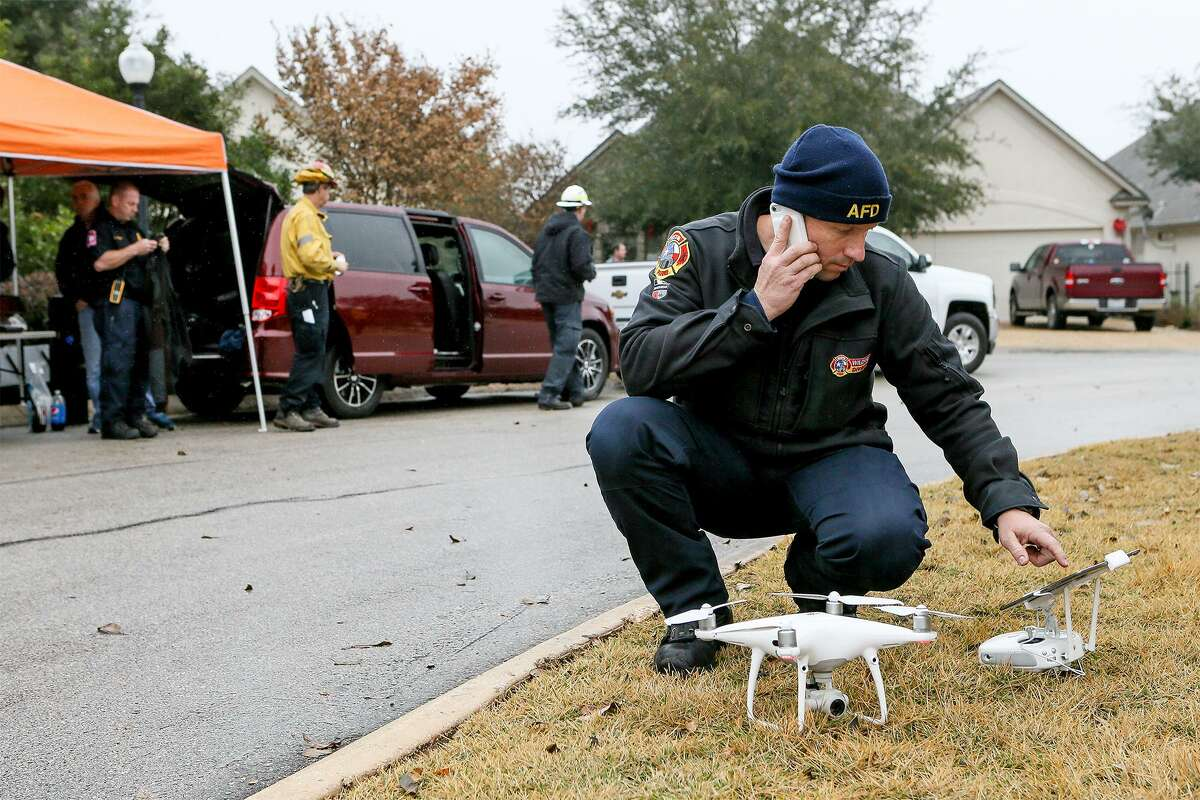 Coitt Kessler with the Austin Fire Department sets up a drone Thursday, Dec. 6, 2018 to oversee a wildfire training exercise in the Roseheart neighborhood on the North Side. Sixty San Antonio firefighters participated in the national training after completing 32 hours of classroom training.