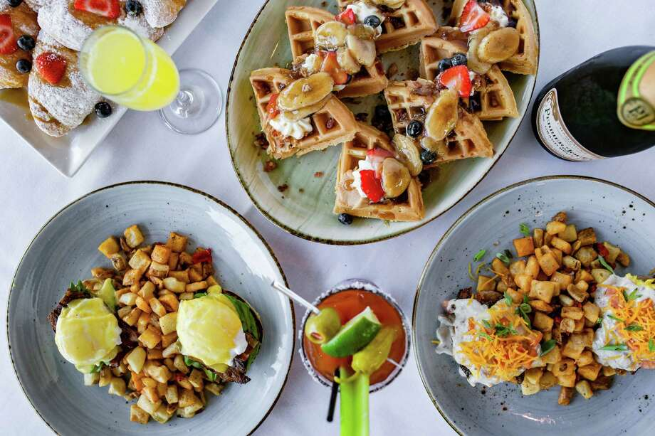 """THE UNION KITCHEN WASHINGTON Why wait for the weekend for brunch? The Union Kitchen on Washington has begun Friday brunch from 11 a.m. to 2 p.m. Brunch is available at all five Houston locations (Washington, Ella, Memorial, Bellaire, and Kingwood) on Saturday and Sunday. Only the Washington location kicks off the weekend with an extra day of brunch and dishes such as pancake sliders, """"Elvis"""" Belgian waffle (topped with peanut butter and Bananas Foster sauce), biscuits and gravy, chilaquiles, blue crab cake Benedict, beignets and fried chicken with biscuits. The brunch menu includes $12.99 mimosas with penny refills. Where: 6011 Washington, 713-242-8151; theunionkitchen.com  What: New Friday brunch service has launched at The Union Kitchen on Washington. On the menu: California Benedict, Elvis Waffles (with peanut butter and Bananas Foster sauce), and One Hot Mess (biscuit with breakfast potatoes, bacon, sausage, eggs and gravy).  Photo: Kirsten Gilliam"""