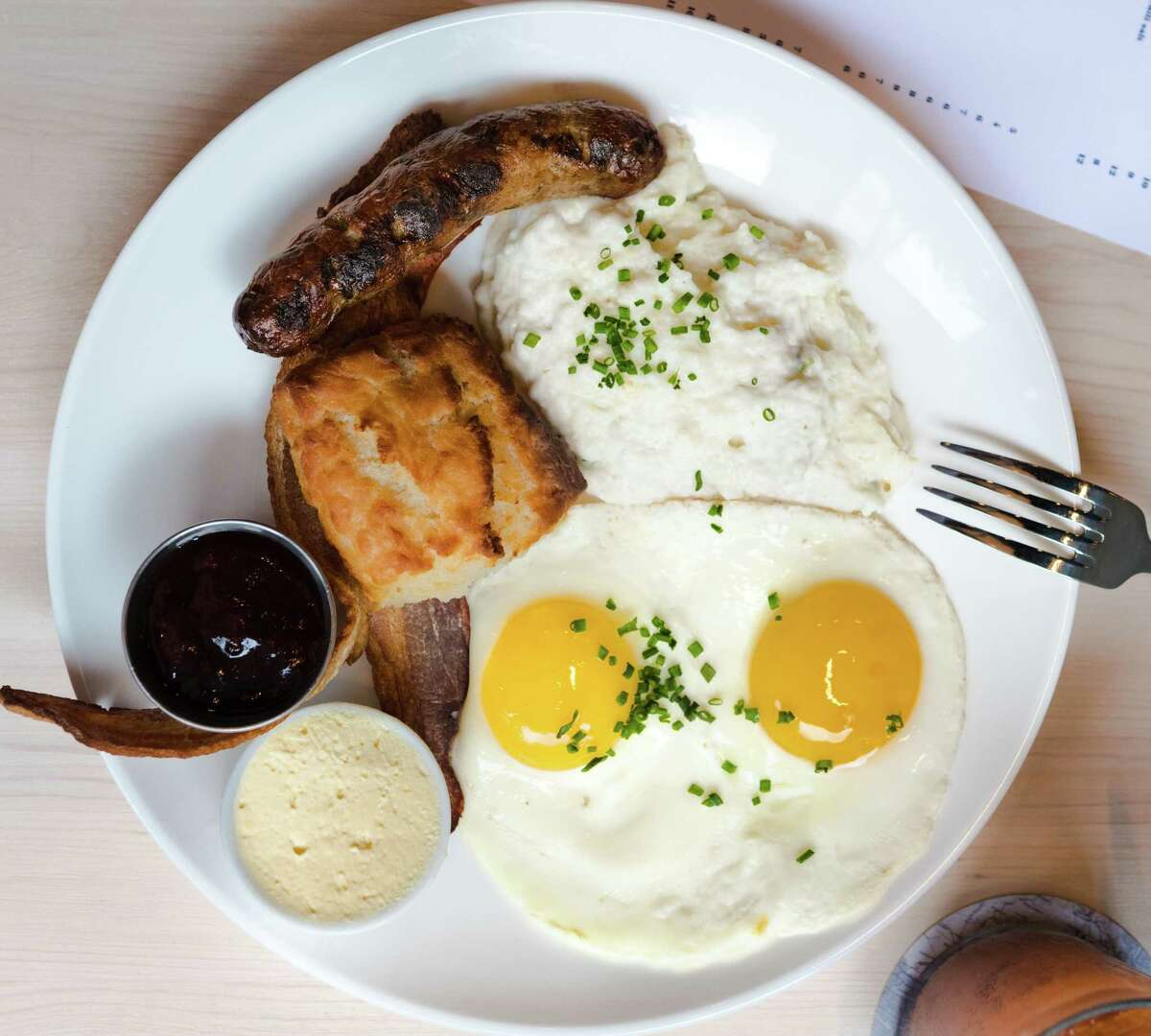 EUNICE The new Cajun-Creole brasserie has launched Sunday brunch service with a menu that includes a southern breakfast (two eggs, grits, bacon, sausage and buttermilk biscuit); steak and eggs; fried quail and biscuits with Tabasco honey; and a blue crab omelet. Also on the brunch menu: Croque Madame, blue crab and Gulf shrimp etouffee, Gulf drum, smoked chicken and sausage gumbo, fried oyster salad, roasted oysters, Cajun duck poppers and seafood platters. Chef Drake Leonards' restaurant is a handsome space, flooded with light, with a generous bar and patio seating. Where: 3737 Buffalo Speedway, 832-491-1717; eunicerestaurant.com What: New Sunday brunch at this Cajun-Creole brasserie includes the Southern breakfast: two eggs any style, stone-ground grits, bacon, sausage and buttermilk biscuit.