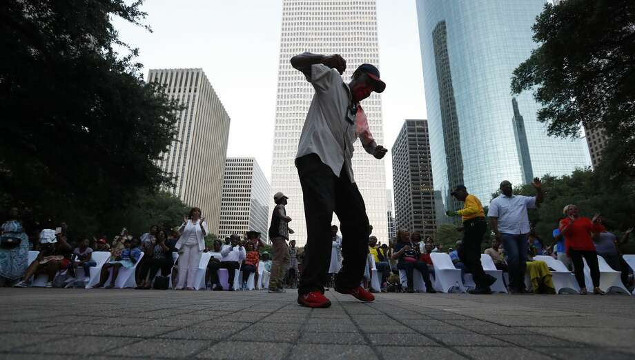 Earnest Jones dances to the music during the Centennial Gospel Sunday Extravaganza as the NAACP Houston chapter celebrated its 100th anniversary at Houston City Hall, Sunday, July 1, 2018, in Houston. Photo: Karen Warren/Staff Photographer