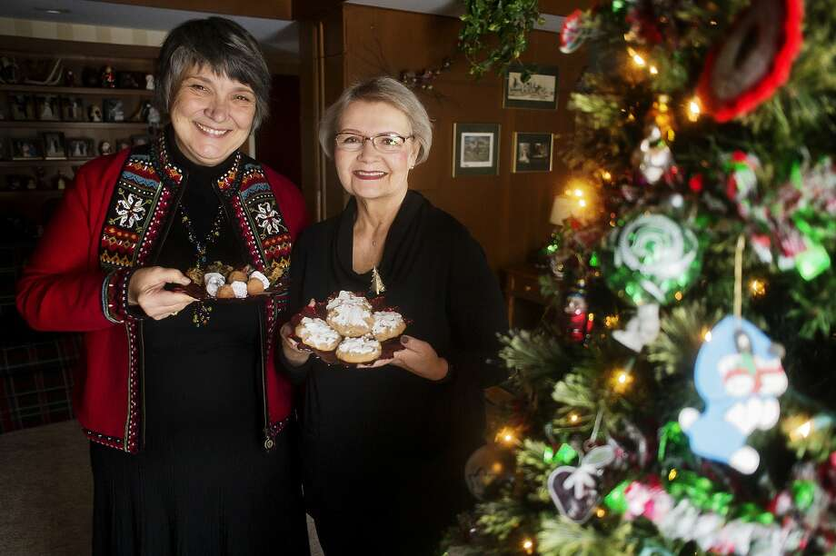 Lorna Stautman, left, and Lynne Engwis, right, pose for a photo with their fruitcake recipes on Nov. 29, 2018 inside Engwis's home in Midland. (Katy Kildee/kkildee@mdn.net) Photo: (Katy Kildee/kkildee@mdn.net)