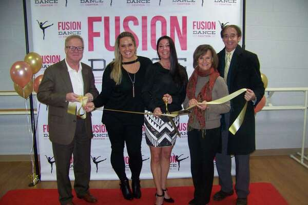 LET'S DANCE: Fusion Dance Center , 21 N. Plains Industrial Road in Wallingford, recently celebrated its grand opening. Pictured are, from left, Tom Curtin, global hr director, Ulbrich Stainless Steels, Quinnipiac Chamber of Commerce board chairman; Angela Loomis, director; Kayt Messina, director; Dee Prior-Nesti, executive director, Quinnipiac Chamber of Commerce; and Mayor William Dickinson. The dance and gymnastics center offers dance education, acrobatics and recreational gymnastics for all ages and ability levels.