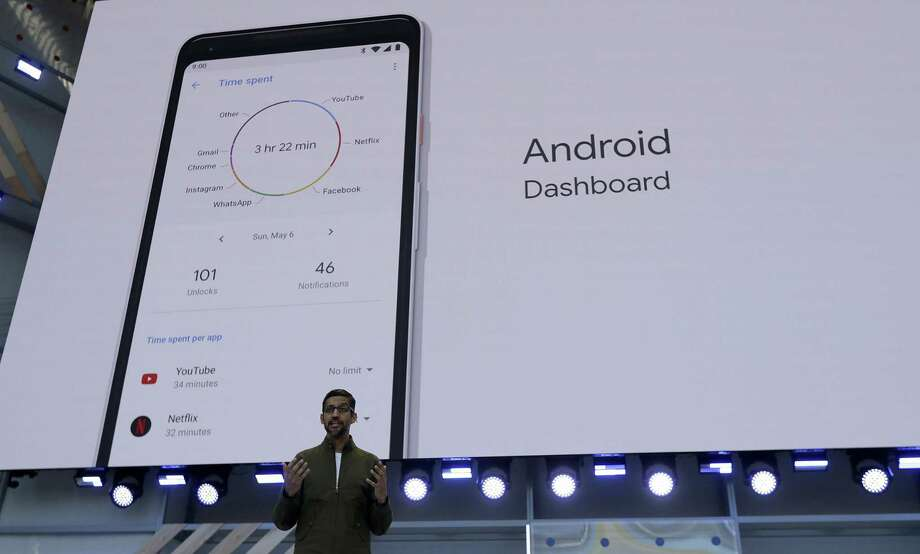 Google CEO Sundar Pichai speaks in May 2018 in Mountain View, Calif., with a display of a Google Android smartphone as a backdrop. In 2017, the cost of mobile phone service dropped by the biggest margin on record, according to new estimates published in December 2018 by the Federal Communications Commission. (AP Photo/Jeff Chiu, File) Photo: Jeff Chiu / Associated Press / Copyright 2018 The Associated Press. All rights reserved.