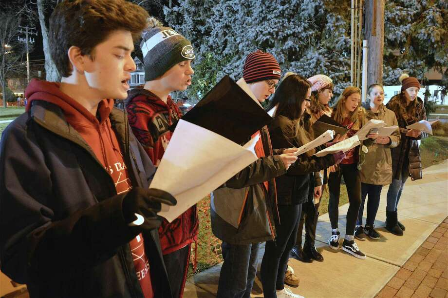 Performers from Warde High School's Muse & Overtones group include, from left, Isaac Liu, 17, Samuel Peterson, 15, and Colman Connolly, 13, at the 6th annual Fairfield Shop & Stroll, Thursday, Dec. 6, 2018, in Fairfield, Conn. Photo: Jarret Liotta / For Hearst Connecticut Media / Fairfield Citizen News Freelance