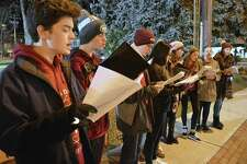 Performers from Warde High School's Muse & Overtones group include, from left, Isaac Liu, 17, Samuel Peterson, 15, and Colman Connolly, 13, at the 6th annual Fairfield Shop & Stroll, Thursday, Dec. 6, 2018, in Fairfield, Conn.
