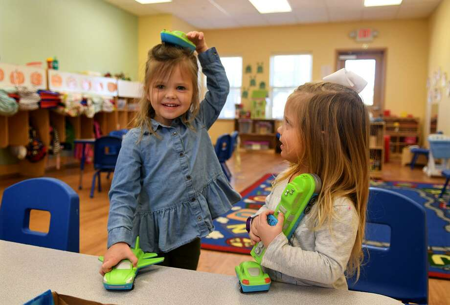 Isla Hajovsky, 3, left, and McKenzie Mauro, 3, try out a Magnetic Mix or Match Vehicles game during their Vivid Imagination class at the Goddard School in Cypress as part of a pre-Christmas toy test on Dec. 5, 2018. Photo: Jerry Baker, Houston Chronicle / Contributor / Houston Chronicle