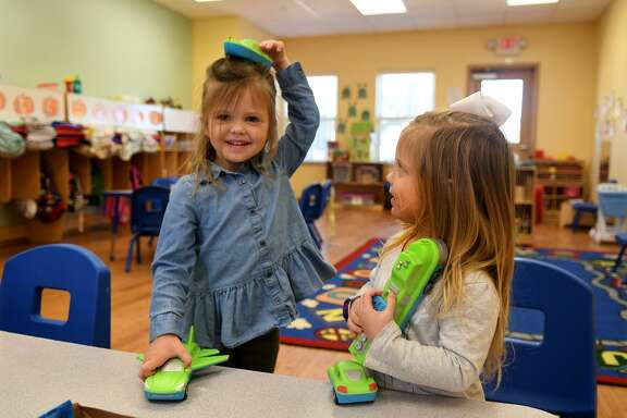 Isla Hajovsky, 3, left, and McKenzie Mauro, 3, try out a Magnetic Mix or Match Vehicles game during their Vivid Imagination class at the Goddard School in Cypress as part of a pre-Christmas toy test on Dec. 5, 2018.