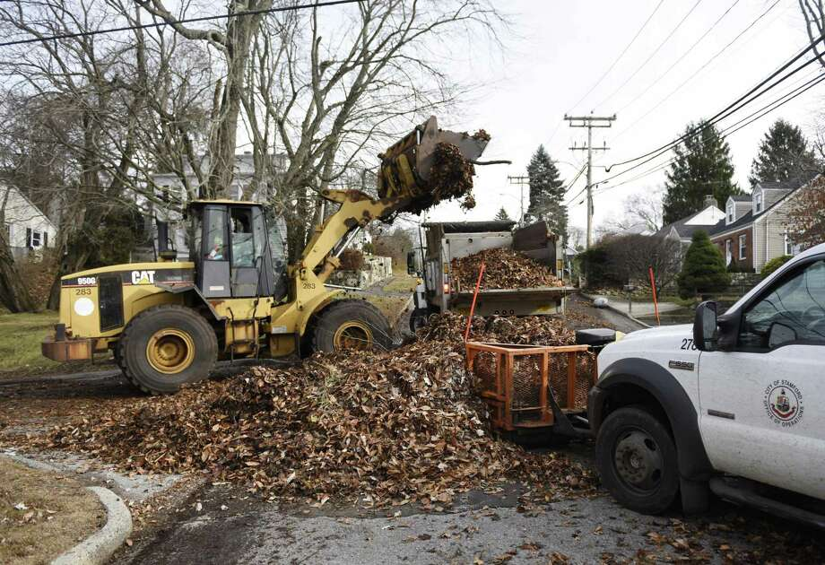 Stamford town employees work to collect leaves on Terrace Avenue in Stamford, Conn. Wednesday, Dec. 5, 2018. Photo: Tyler Sizemore / Hearst Connecticut Media / Greenwich Time