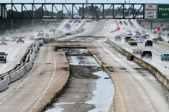Empty lanes split the east and west bound lanes of Highway 290 as seen from the Barker Cypress overpass on Sept. 13, 2018.