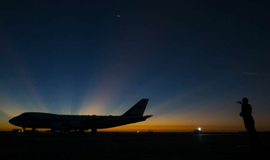 The sun rises over Special Air Mission 41 as it sits on the tarmac at Ellington Field Joint Reserve Base on Monday, Dec. 3, 2018, in Houston. The aircraft will fly the body of President George H.W. Bush to Washington, D.C. to begin a week of ceremonies honoring the 41st President of the United States. Photo: Brett Coomer/Staff Photographer