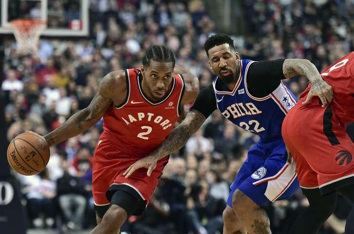 Toronto Raptors forward Kawhi Leonard (2) moves pass Philadelphia 76ers forward Wilson Chandler (22) during the first half of an NBA basketball game, Wednesday, Dec. 5, 2018 in Toronto. (Frank Gunn/The Canadian Press via AP)