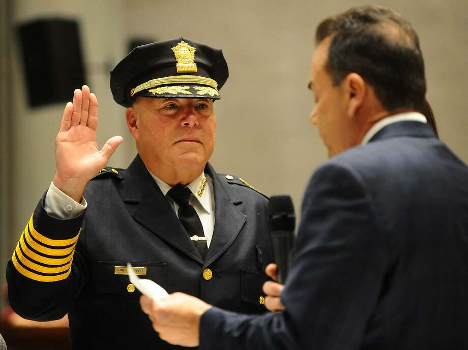 Armando Perez is sworn in as Bridgeport police chief by Mayor Joe Ganim in a ceremony at City Hall in Bridgeport on Nov. 13. Photo: Brian A. Pounds / Hearst Connecticut Media / Connecticut Post