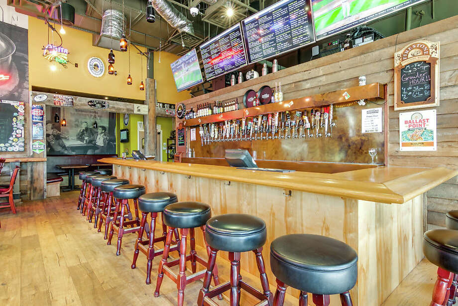 A full-furnished craft beer bar in Stone Oak is on the market for $120,000. The bar was formerly Claude Hopper's, which closed about a month ago. Photo: Courtesy Of Restaurant Realty Group