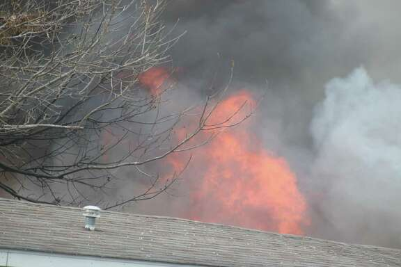 Flames rose high above a mobile home that burned Friday morning in Pasadena.