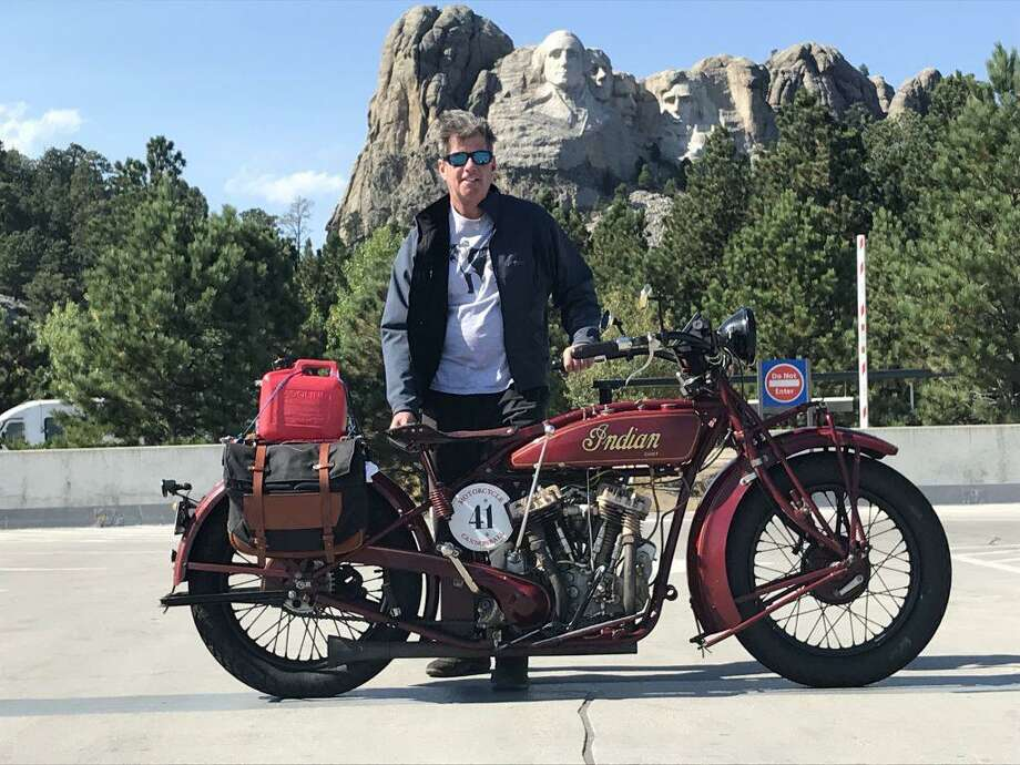 Ridgefielder Jeff McAllister with his 1927 Indian Big Chief at Mount Rushmore. He recently completed a 3,750 mile journey on the bike as part of the Motorcycle Cannonball. Photo: Contributed Photo / Contributed / The News-Times Contributed