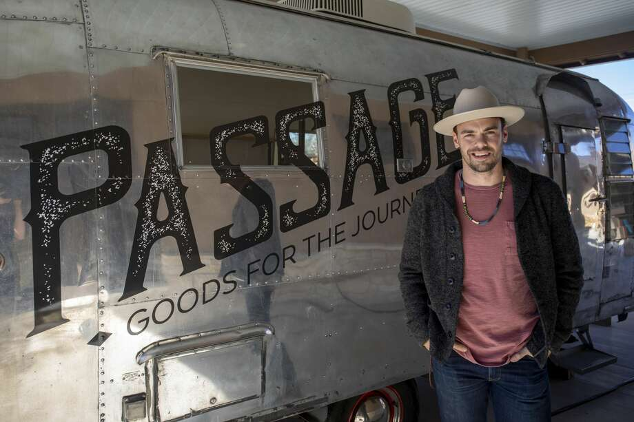 Tyler Snelson stands in front of his Passage Goods airstream trailers Nov. 27. Photo: Jacy Lewis/191 News