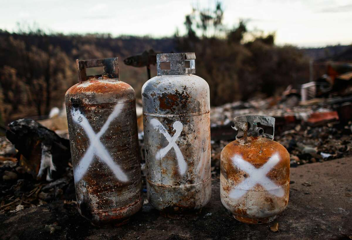 EPA contractors marked and set aside propane takes for removal after they were destroyed by the Camp Fire in Paradise, California, on Wednesday, Dec. 5, 2018.