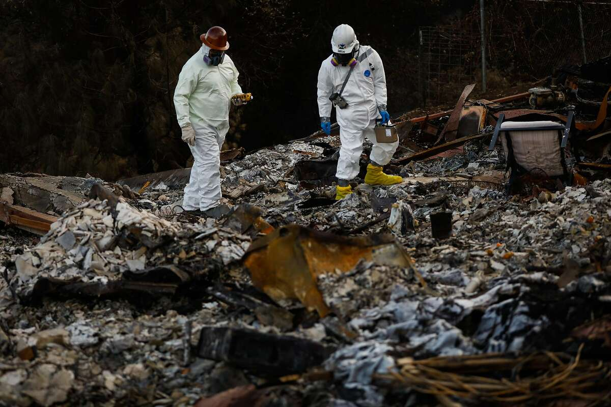 Contractors with the EPA look for hazardous materials at the site of a house that burned in the Camp Fire in Paradise, California, on Wednesday, Dec. 5, 2018.