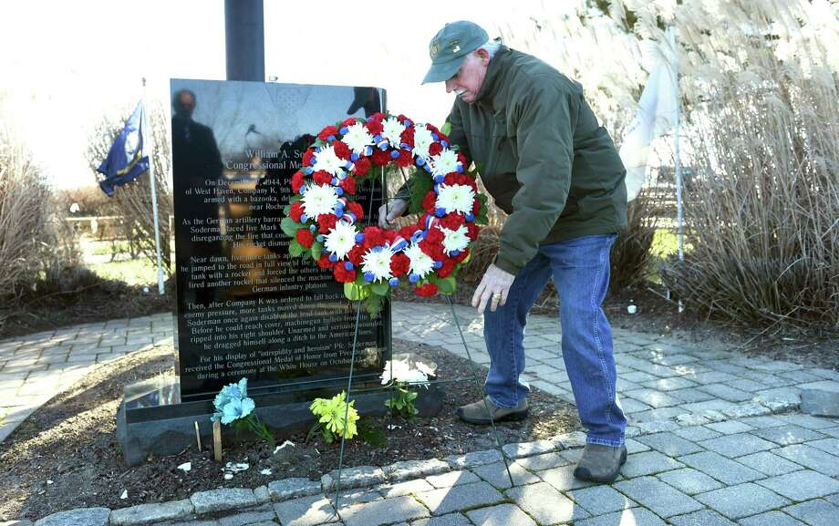 Vietnam veteran Dave Ricci of West Haven lays a wreath at the William A. Soderman Memorial Flagpole during a commemoration of the 77th anniversary of the Japanese bombing of Pearl Harbor at Bradley Point Park in West Haven on December 7, 2018. Photo: Arnold Gold / Hearst Connecticut Media / New Haven Register