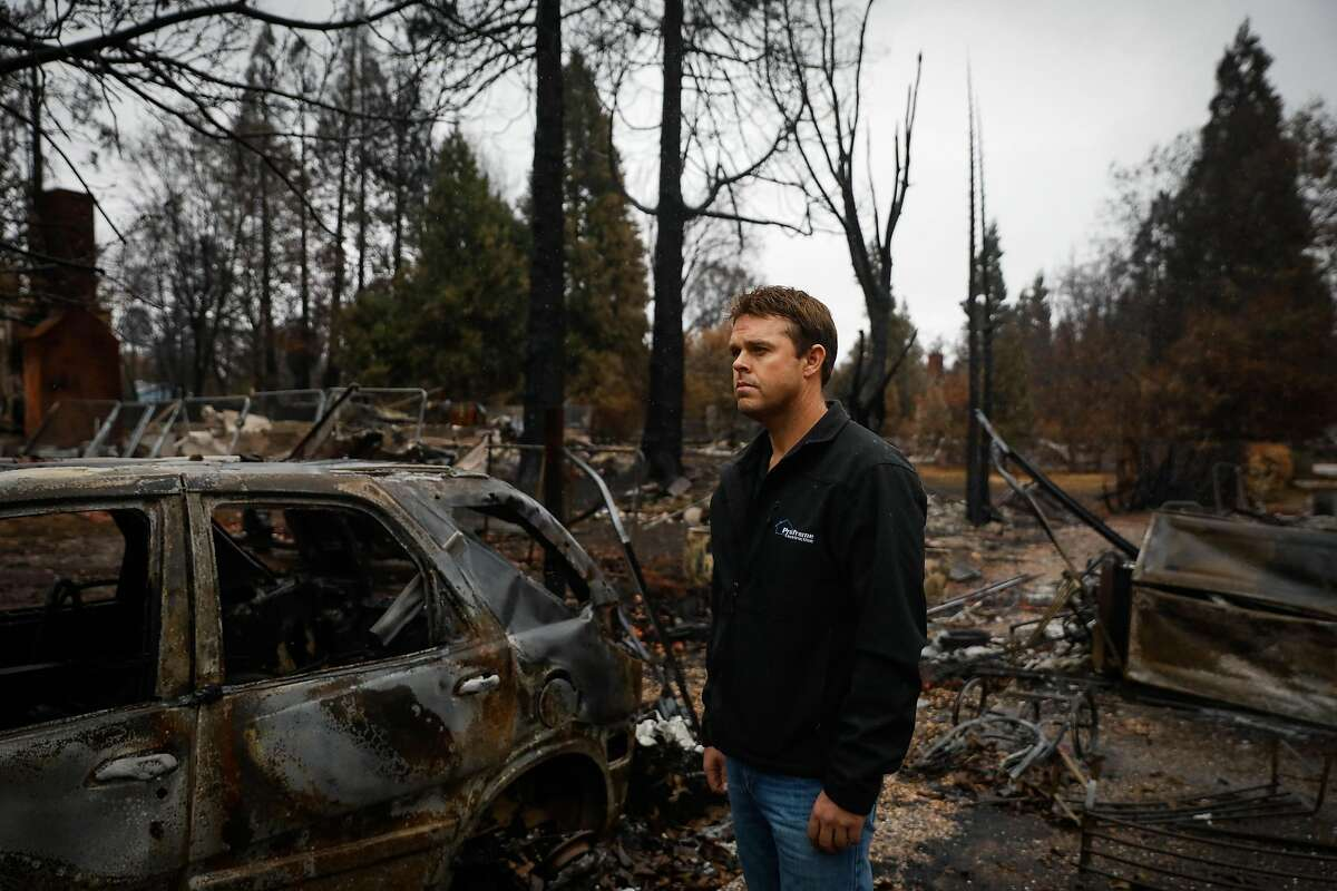 Ben Eckstrom, a Chico contractor and head of the Valley Contractors Exchange stands for a portrait in a destroyed area of Paradise, California, on Thursday, Nov. 29, 2018.