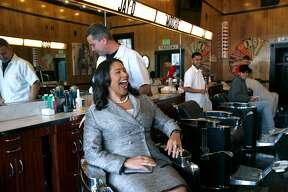 Mayor London Breed stops by to visit with Mike Stevens in his barber shop on lower Haight Street in San Francisco, Calif. on Friday, Dec. 7, 2018. Next week, Mayor Breed will announce an initiative to address retail vacancies throughout the city.