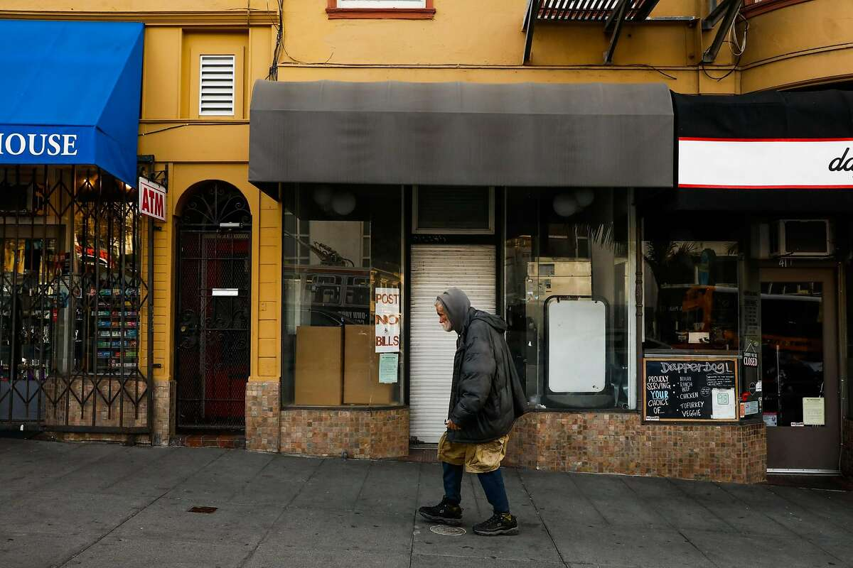 A person passes by a shuttered storefront on Castro Street in San Francisco, California, on Monday, Oct. 29, 2018.