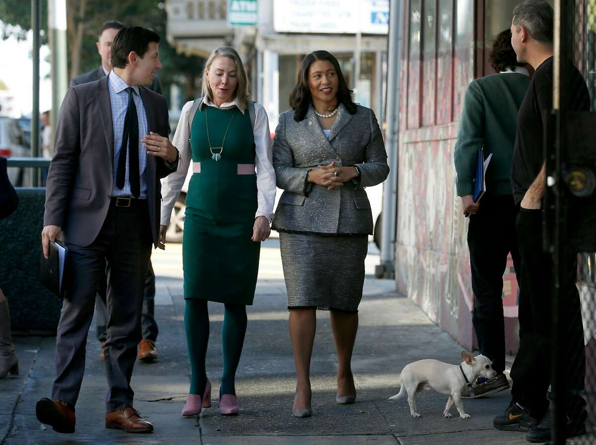 Mayor London Breed visits with small business owners on lower Haight Street with Joaquin Torres (left), director of the Office of Economic & Workforce Development, and Supervisor Vallie Brown in San Francisco, Calif. on Friday, Dec. 7, 2018. Next week, Mayor Breed will announce an initiative to address retail vacancies throughout the city.