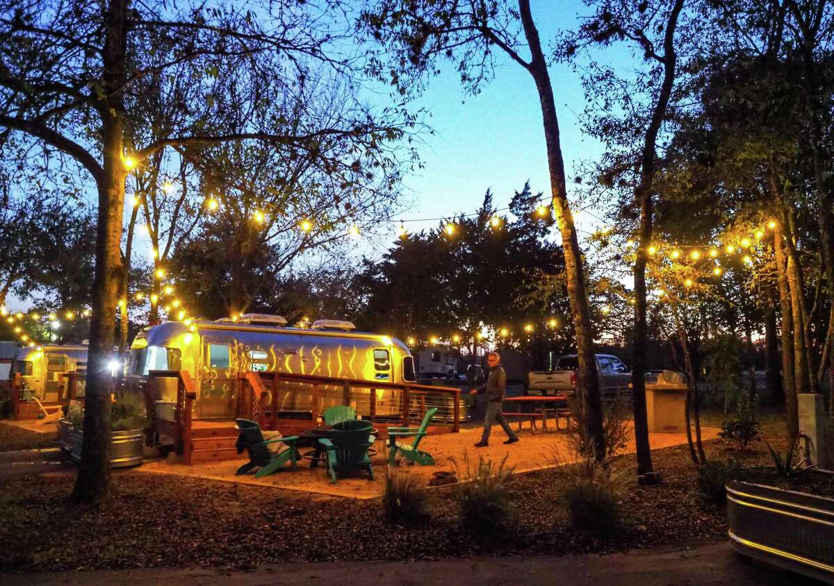 The newly installed Airstream trailers at North Shore Lake Bastrop park feature an outdoor seating area with fire pit and gas grill.