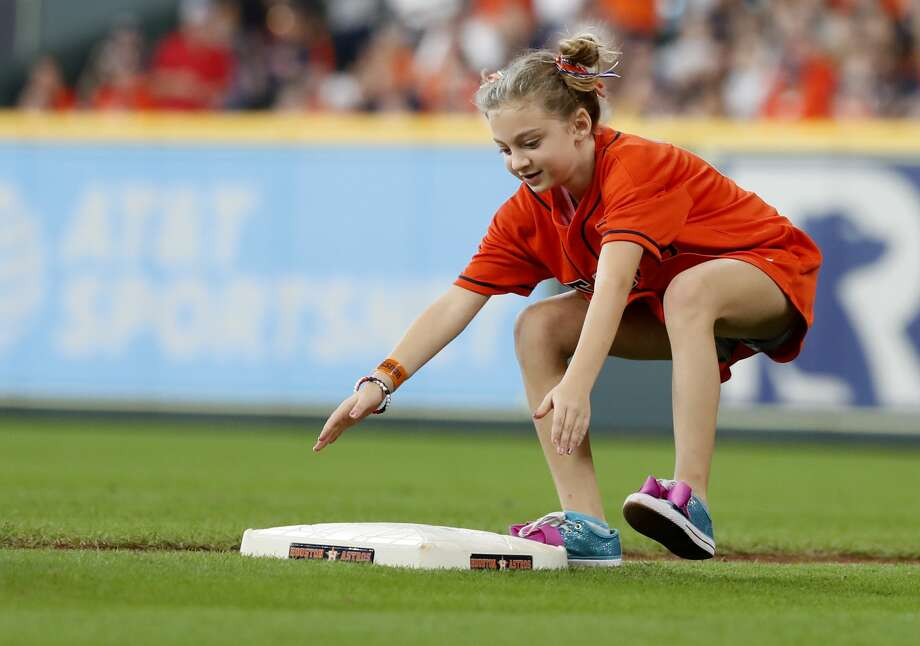 Chloe Beaver, 8, steals a base during Game 1 of the American League Division Series at Minute Maid Park on Friday, Oct. 5, 2018, in Houston. Photo: Karen Warren/Houston Chronicle