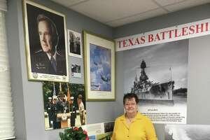 """Betty Edmundson, assistant museum curator, Katy Veterans Memorial Museum, belonged to VFW Museum Committee when members first mentioned the possibility of President George H.W. Bush dedicating their facility. """"It caused quite a show when he replied that he'd like to be here,"""" she said. A section of the museum is dedicated to Bush."""