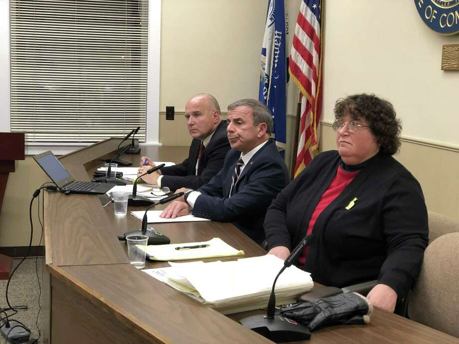 North Haven residents and officials spoke out Thursday against a threatening letter recently received by Danielle Morfi. Here, the Board of Selectmen - William Pieper, Michael Freda, and Sally Buemi - listens to remarks. Photo: Ben Lambert / Hearst Connecticut Media /