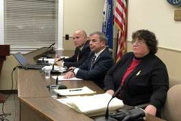 North Haven residents and officials spoke out Thursday against a threatening letter recently received by Danielle Morfi. Here, the Board of Selectmen - William Pieper, Michael Freda, and Sally Buemi - listens to remarks.