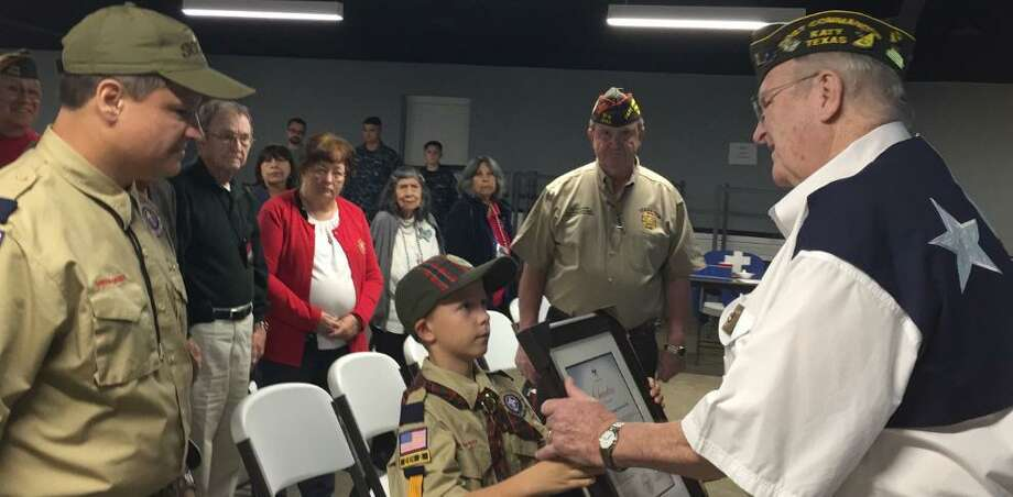 Robb Flynn, Cubmaster; Wilbur Duvall WWII veteran; Peyton Lumpkin, past post and state commander; Donald Byrne, Katy VFW Post 9182 commander and Cub Scout Brian Hubbard, a Webelo I in Pack 494, present its charter. The post's chartered Cub Scout Pack 494 did a flag ceremony at the Dec. 3 meeting of the post and auxiliary. The post's sponsored Sea Cadets did a Pearl Harbor presentation. Photo: Courtesy Katy VFW Post 9182 / Courtesy Katy VFW Post 9182