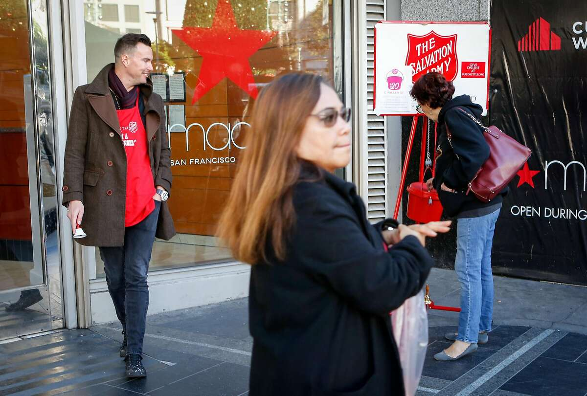 Salvation Army bell ringer Kenneth Chinn rings a bell outside of Macy's as Jane Drury makes a donation on Thursday, Nov 6, 2018 in downtown San Francisco, Calif.