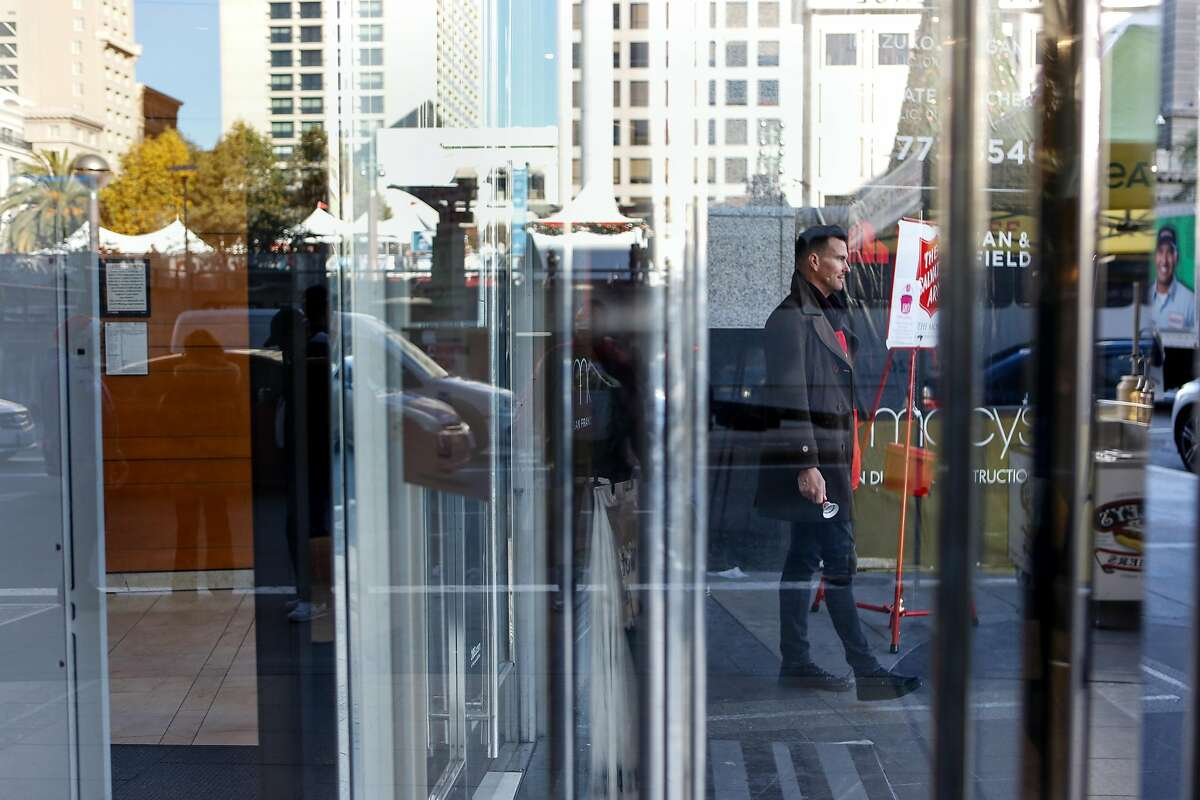 Salvation Army bell ringer Kenneth Chinn rings a bell outside of Macy's on Thursday, Nov 6, 2018 in downtown San Francisco, Calif.