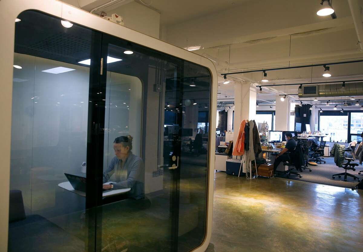 Marla Landa works inside a soundproof pod in Asana software company offices in San Francisco, Calif. on Wednesday, Dec. 5, 2018.