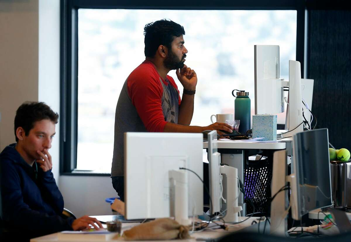 Employees work in Asana software company offices in San Francisco, Calif. on Wednesday, Dec. 5, 2018.