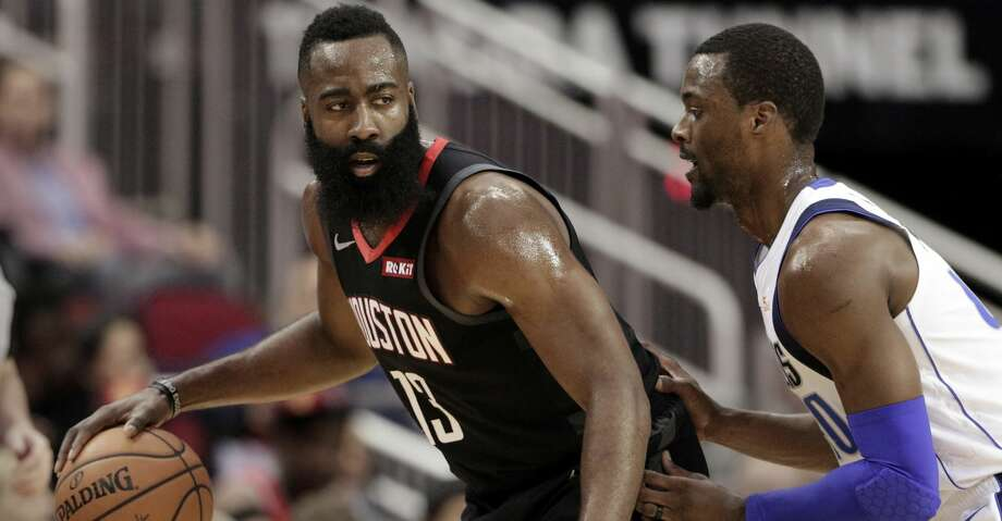 Houston Rockets guard James Harden (13) looks to get around Dallas Mavericks forward Harrison Barnes (40) during the first half of an NBA basketball game Wednesday, Nov. 28, 2018, in Houston. (AP Photo/Michael Wyke) Photo: Michael Wyke/Associated Press