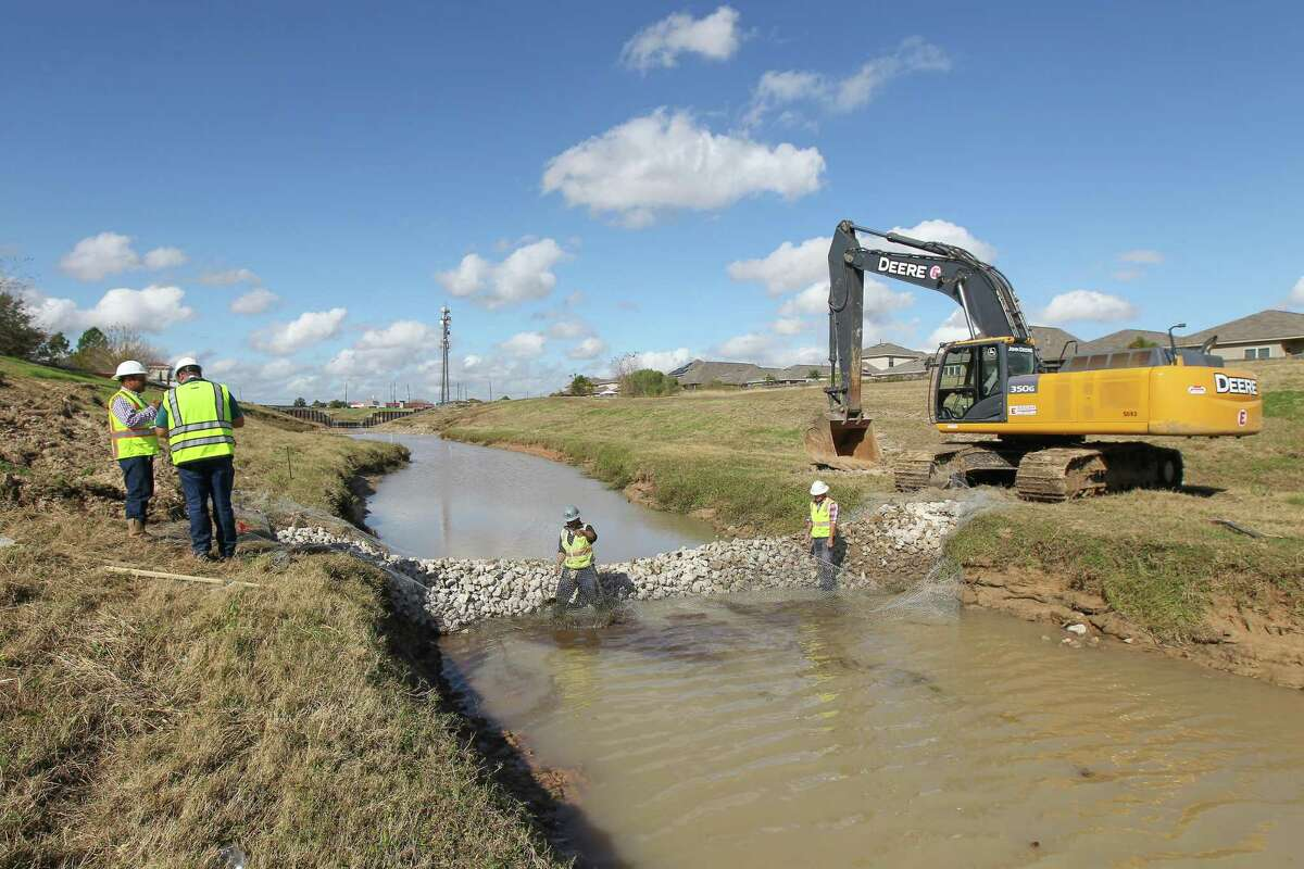 The Harris County Flood Control District is in the process of repairing damage caused by Hurricane Harvey near Fry Road and Bear Creek Friday, Nov. 30, 2018, in Katy.