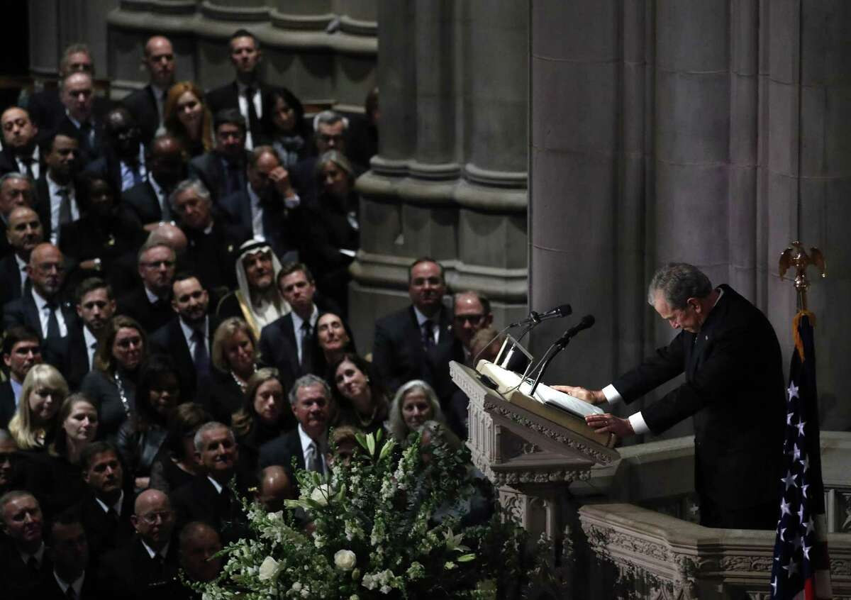George W. Bush breaks down as he delivers a eulogy for his father during the State Funeral for George H.W. Bush at the Washington National Cathedral.