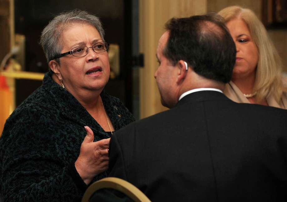 Rosa J. Correa, Manager of External Relations and Business Development at Family ReEntry talks with Jeffrey Earls at former Mayor Bill Finch's address to the business community on March, 14, 2012 at the Bridgeport Holiday Inn & Conference Center. Correa is a Republican who voted straight Democrat in 2018 because of her opposition to President Donald Trump. Photo: Cathy Zuraw / Hearst Connecticut Media / Connecticut Post