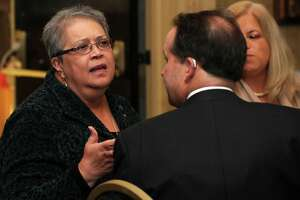 Rosa J. Correa, Manager of External Relations and Business Development at Family ReEntry talks with Jeffrey Earls at former Mayor Bill Finch's address to the business community on March, 14, 2012 at the Bridgeport Holiday Inn & Conference Center. Correa is a Republican who voted straight Democrat in 2018 because of her opposition to President Donald Trump.