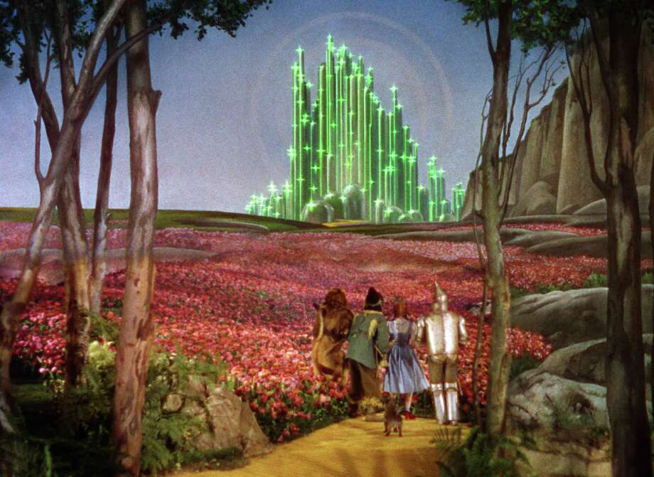 "Dorothy, the Scarecrow, the Lion, and the Tin Man make their way to the Emerald City in ""The Wizard of Oz."" Photo: Turner Entertainment Co. / SFC"
