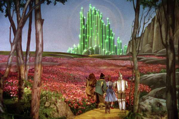 "Dorothy, the Scarecrow, the Lion, and the Tin Man make their way to the Emerald City in ""The Wizard of Oz."""
