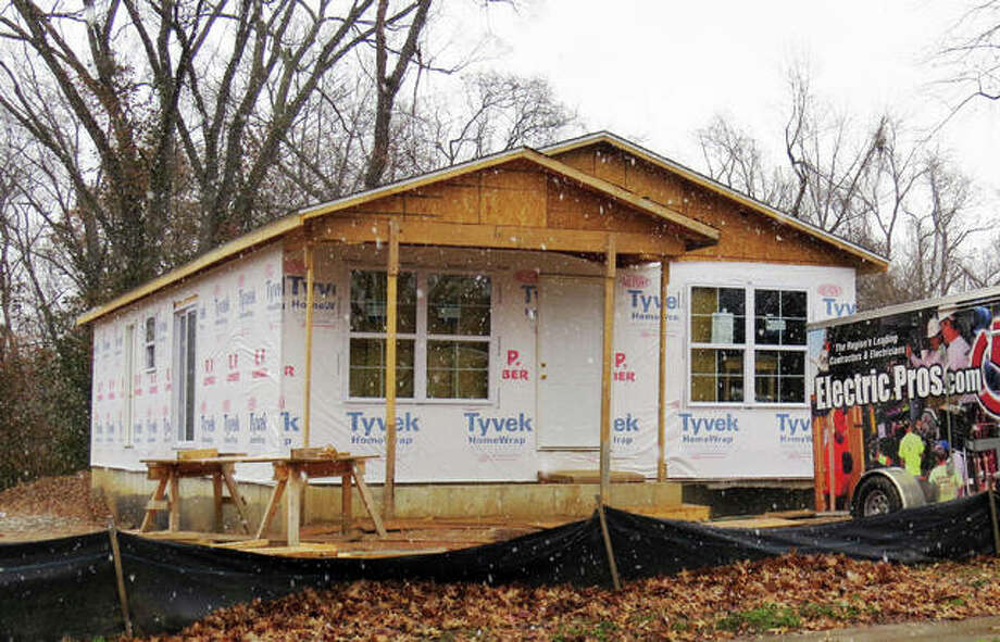 The latest Habitat for Humanity house on Klein Street in Edwardsville. The house was recently enclosed and work will now move to the inside of the house. Photo: Carol Arnett | For The Intelligencer