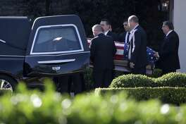 Members of the U.S. Secret Service carry the casket of former President George H.W. Bush after a family service Monday in Houston. A reader draws contrasts between Presidents Bush and Donald Trump.