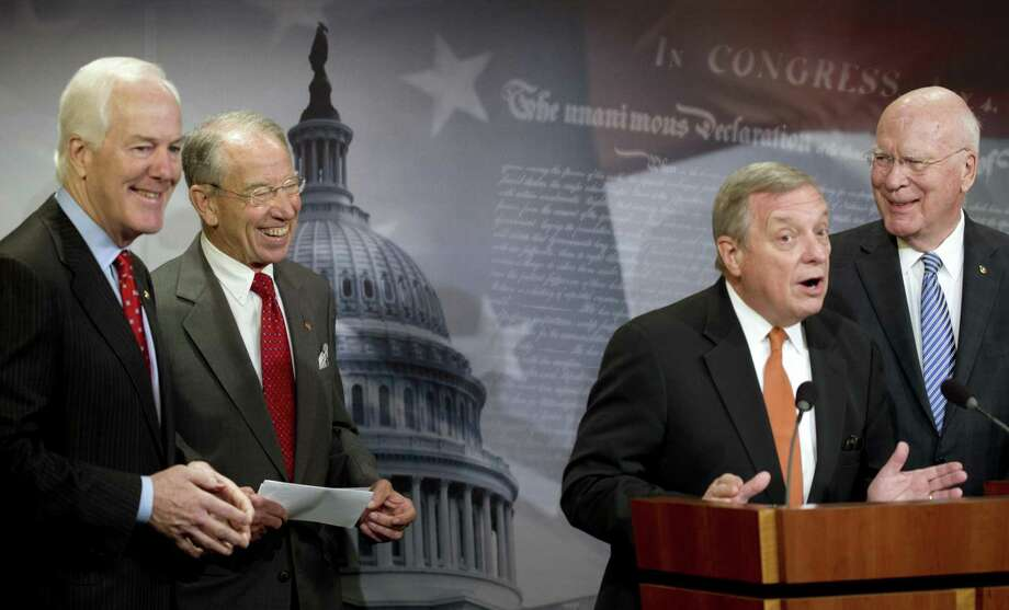 Sens. John Cornyn, R-Texas, from left, Charles Grassley, R-Iowa, Dick Durbin, D-Ill., and Patrick Leahy, D-Vt.. announce bipartisan agreement on criminal justice system reform Oct. 1, 2015. Three years later, there is yet another compromise that Congress should make law. Photo: New York Times File Photo / NYTNS